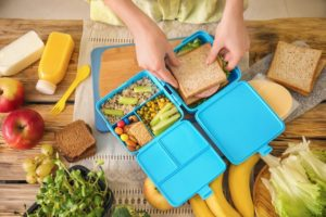 A healthy lunch being packed into a container