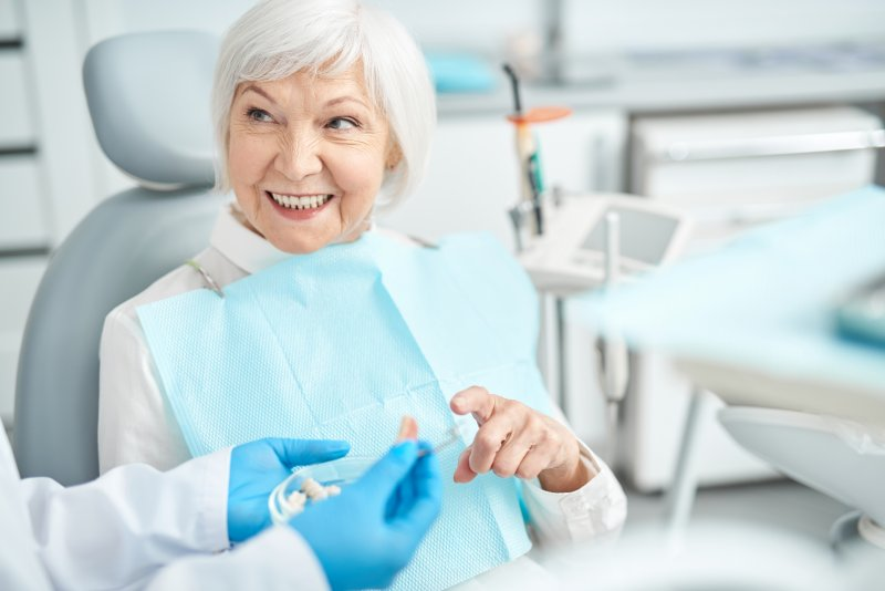 dental implant consultation with older woman