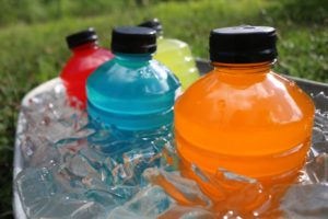 A bucket of sports drinks that a dentist says can be harmful to teeth