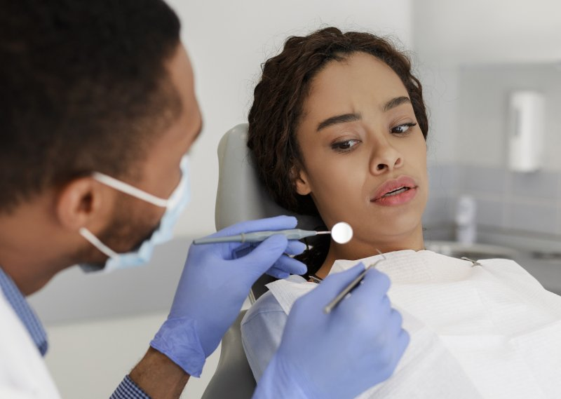 Woman feeling anxious during dental exam