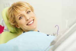 female patient in dentist chair