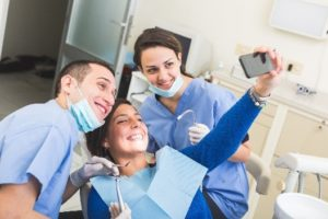 Patient taking selfie with dentist